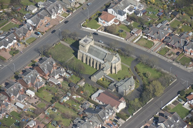 Oblique aerial view of the Chapel of our Lady of the Assumption and St Meddan Church, looking NNE.