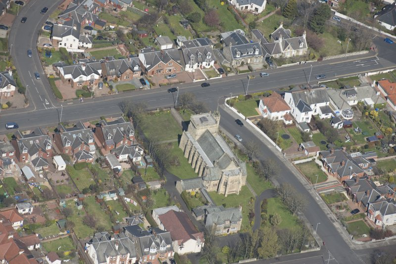 Oblique aerial view of the Chapel of our Lady of the Assumption and St Meddan Church, looking NNW.