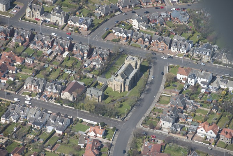 Oblique aerial view of the Chapel of our Lady of the Assumption and St Meddan Church, looking NW.