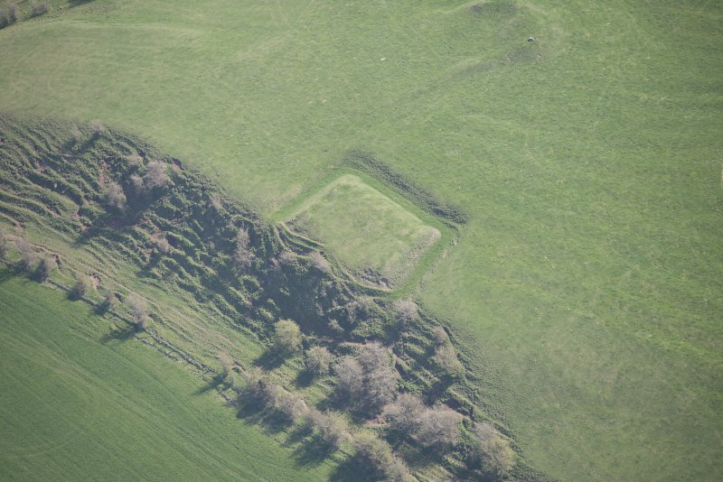Oblique aerial view of Barnweill moated site, looking ESE.