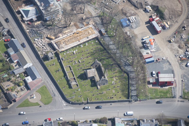 Oblique aerial view of Monkton Old Parish Church and cemetery, looking E.
