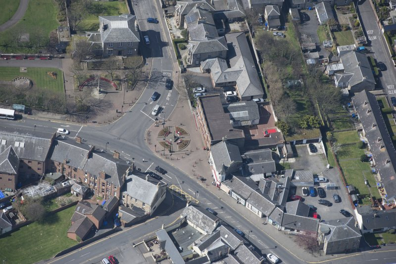 Oblique aerial view of Prestwick Market Cross, looking W.