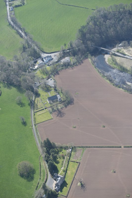 Oblique aerial view of Stair Parish Church, Stair House and Stair Bridge, looking W.