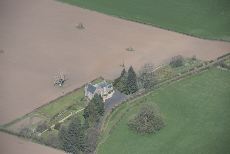 Oblique aerial view of Stair Parish Church and Stair House, looking NNW.