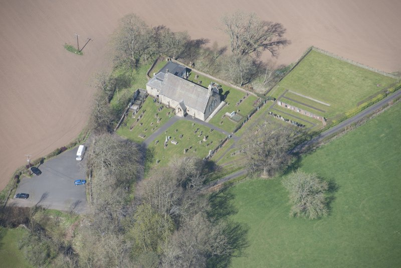 Oblique aerial view of Stair Parish Church, looking NW.