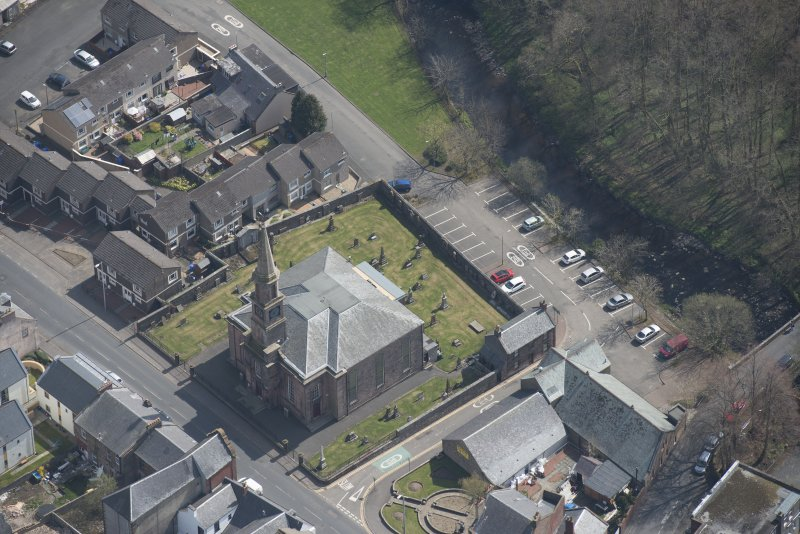 Oblique aerial view of Loudoun Old Parish Church and Newmilns Churchyard, looking ESE.