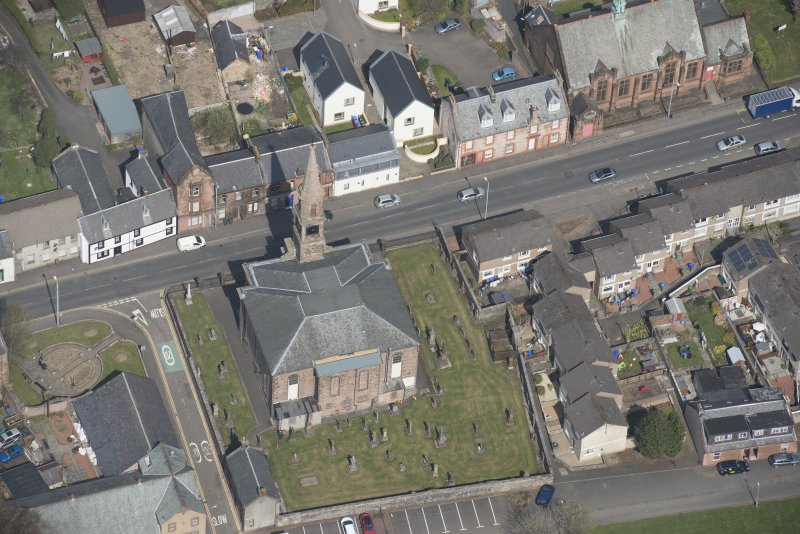 Oblique aerial view of Loudoun Old Parish Church and Newmilns Churchyard, looking N.