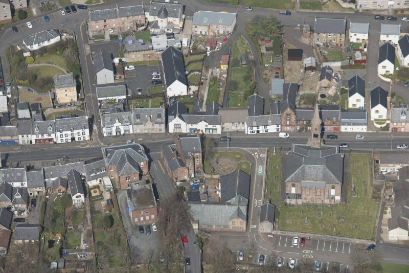 Oblique aerial view of Loudoun Old Parish Church, Newmilns Tower and Newmilns Churchyard, looking ESE.