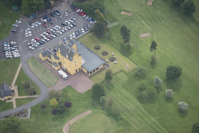 Oblique aerial view of Pitfirrane Castle, looking SE.