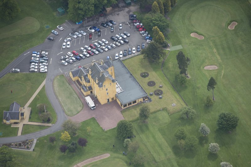 Oblique aerial view of Pitfirrane Castle, looking ESE.