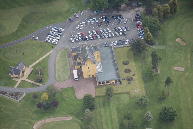 Oblique aerial view of Pitfirrane Castle, looking E.