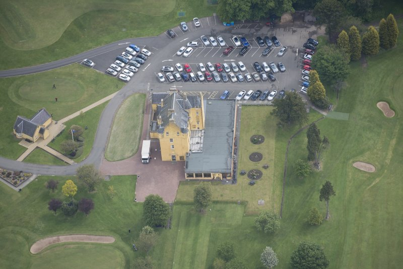 Oblique aerial view of Pitfirrane Castle, looking ENE.
