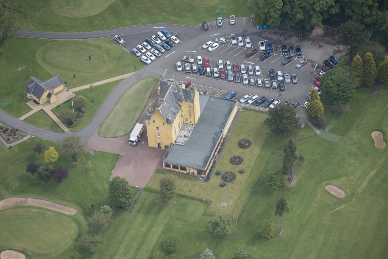 Oblique aerial view of Pitfirrane Castle, looking NE.