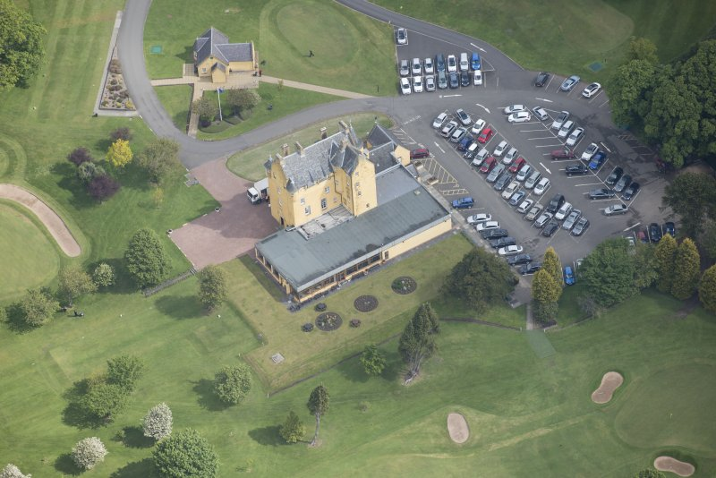 Oblique aerial view of Pitfirrane Castle, looking NNE.