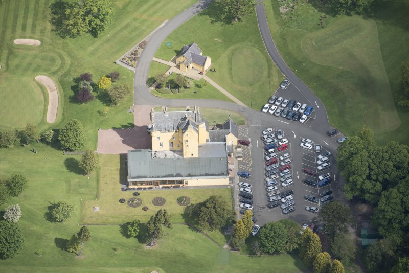 Oblique aerial view of Pitfirrane Castle, looking N.
