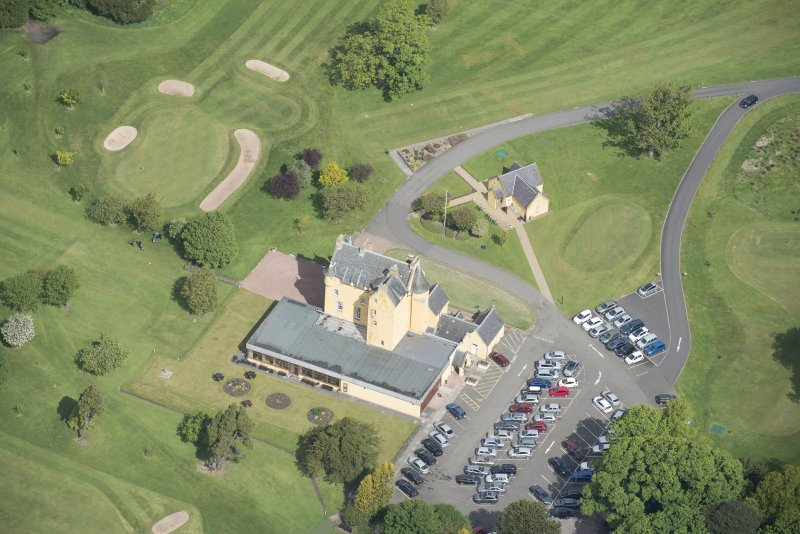 Oblique aerial view of Pitfirrane Castle, looking NNW.