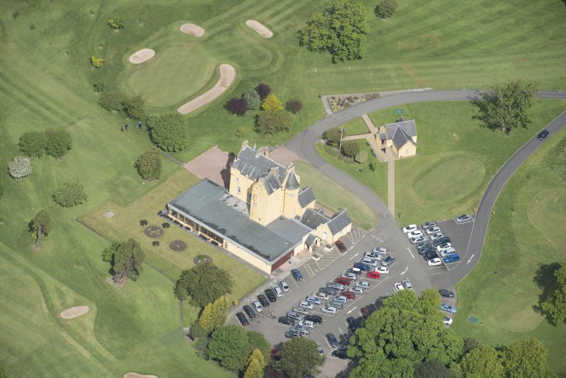 Oblique aerial view of Pitfirrane Castle, looking NW.