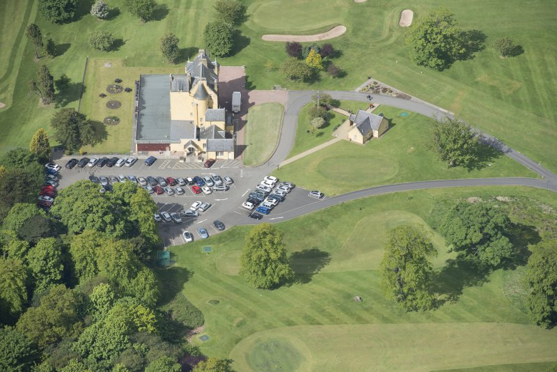 Oblique aerial view of Pitfirrane Castle, looking WSW.