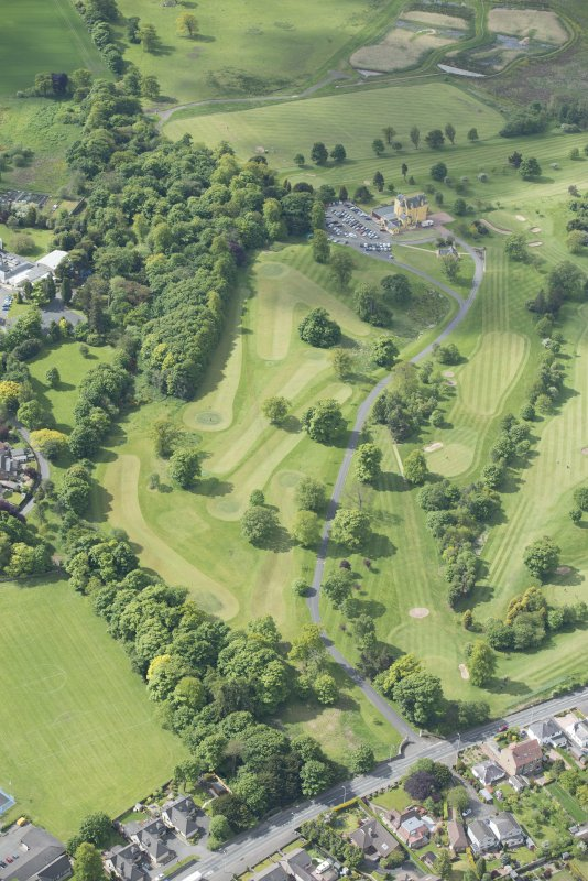 Oblique aerial view of Pitfirrane Golf Course, Pitfirrane Castle and gate piers, looking SSW.