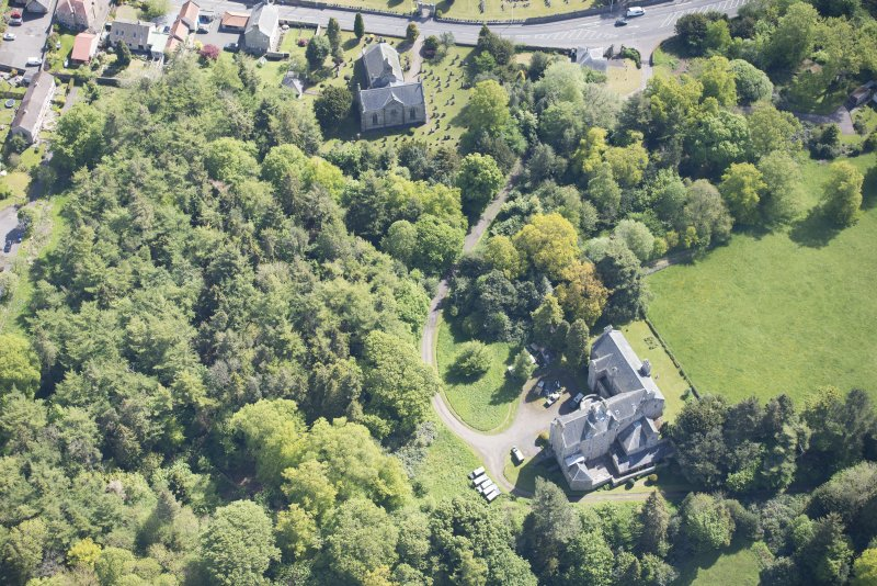 Oblique aerial view of Mid Calder Parish Church and Calder House, looking ENE.