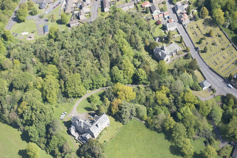 Oblique aerial view of Mid Calder Parish Church and Calder House, looking NNE.