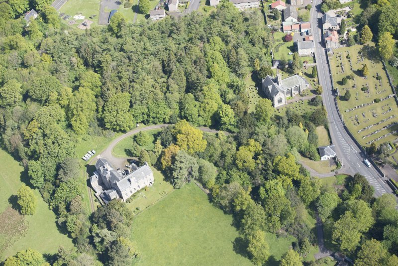 Oblique aerial view of Mid Calder Parish Church and Calder House, looking N.