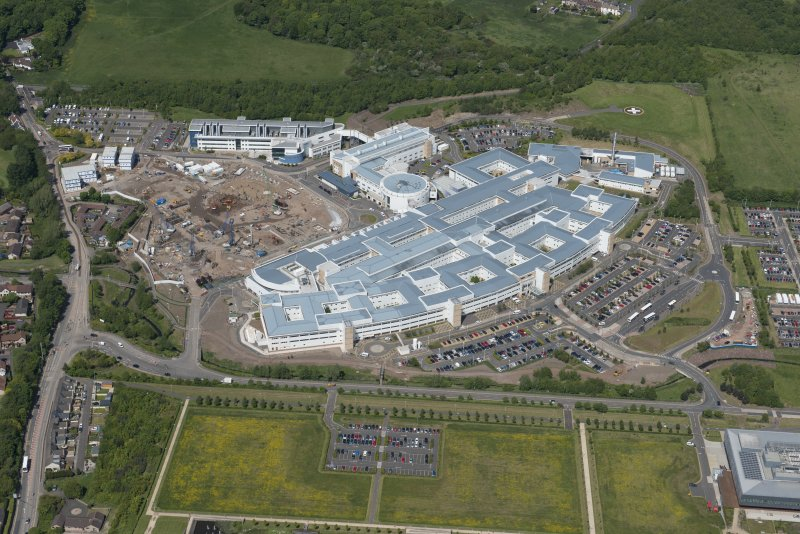 Oblique aerial view of the Royal Infirmary of Edinburgh and the construction of the new Royal Infirmary for Sick Children, looking NW.