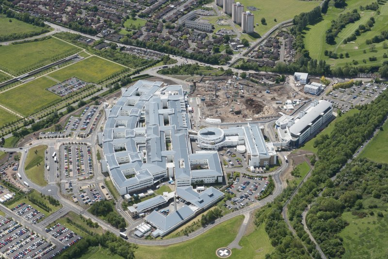 Oblique aerial view of the Royal Infirmary of Edinburgh and the construction of the new Royal Infirmary for Sick Children, looking SSW.