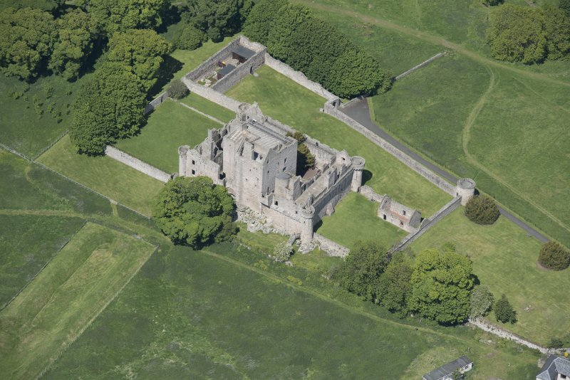 Oblique aerial view of Craigmillar Castle, looking NW.