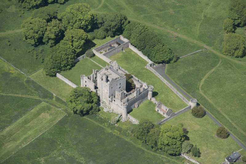 Oblique aerial view of Craigmillar Castle, looking WNW.