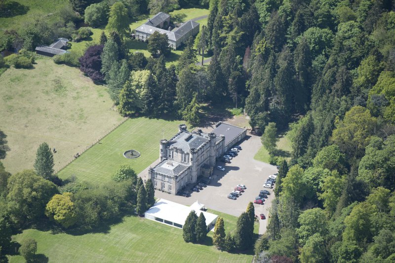 Oblique aerial view of Melville Castle, looking SW.