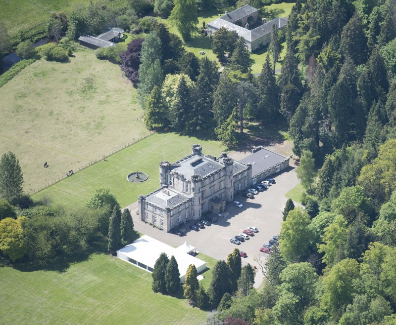 Oblique aerial view of Melville Castle, looking SSW.