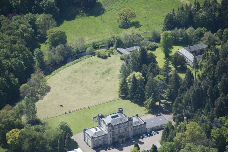 Oblique aerial view of Melville Castle, looking S.