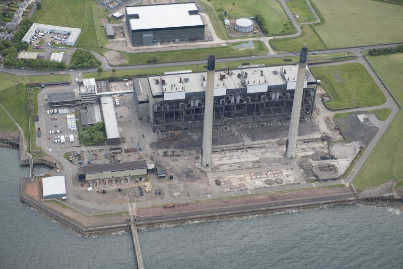 Oblique aerial view of the demolition of Cockenzie Power Station, looking SSE.