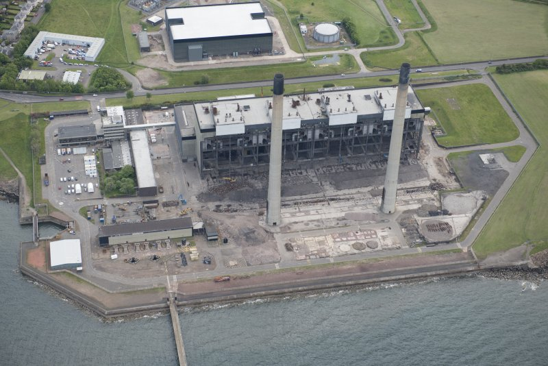 Oblique aerial view of the demolition of Cockenzie Power Station, looking SE.