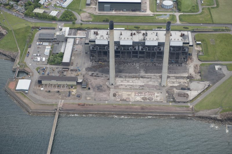 Oblique aerial view of the demolition of Cockenzie Power Station, looking ESE.