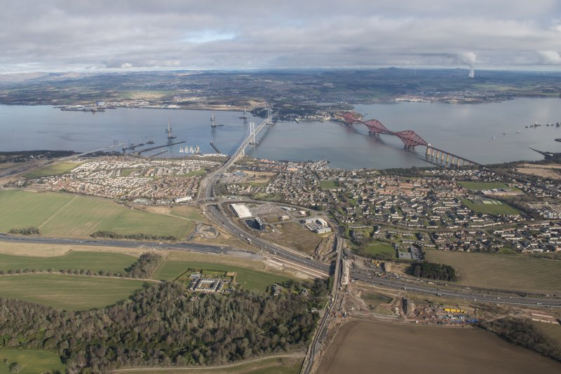 Oblique aerial view of the construction of the Queensferry Crossing, the Forth Road Bridge and the Forth Bridge, looking N.