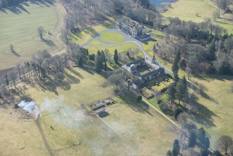 Oblique aerial view of the Penicuik House and stables, looking S.