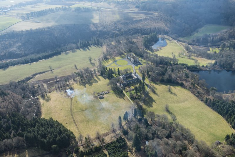 General oblique aerial view of the Penicuik House and stables, looking W.