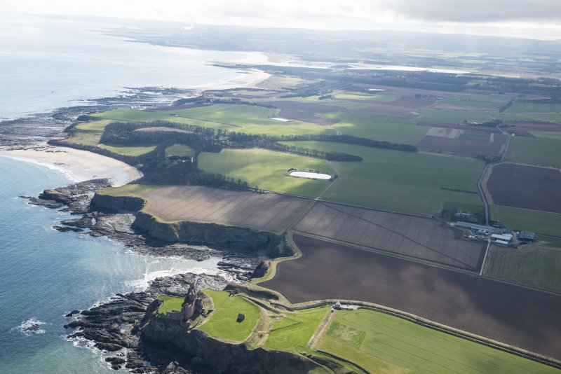 General oblique aerial view along the East Lothian coastline with Tantallon Castle in the foreground, looking SE.