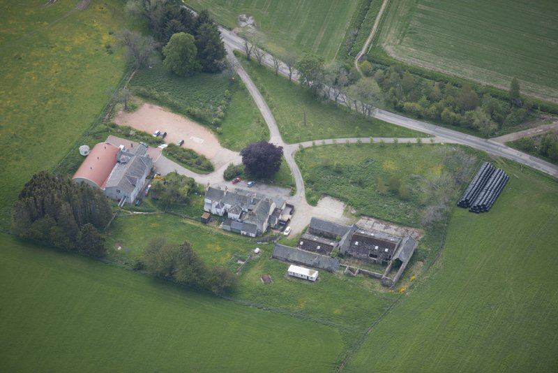 Oblique aerial view of Colquhonnie Hotel and Colquhonnie Castle, looking S.