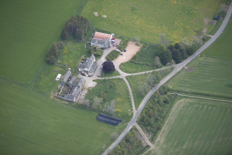 Oblique aerial view of Colquhonnie Hotel and Colquhonnie Castle, looking E.