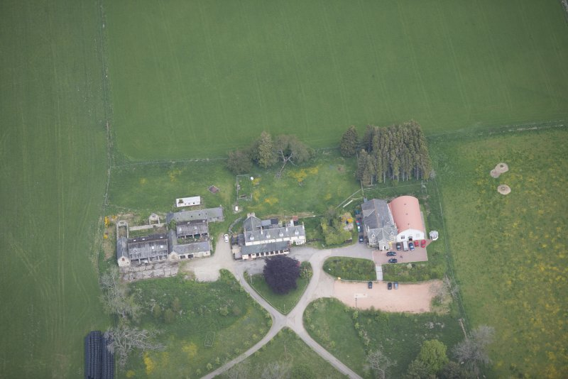 Oblique aerial view of Colquhonnie Hotel and Colquhonnie Castle, looking N.