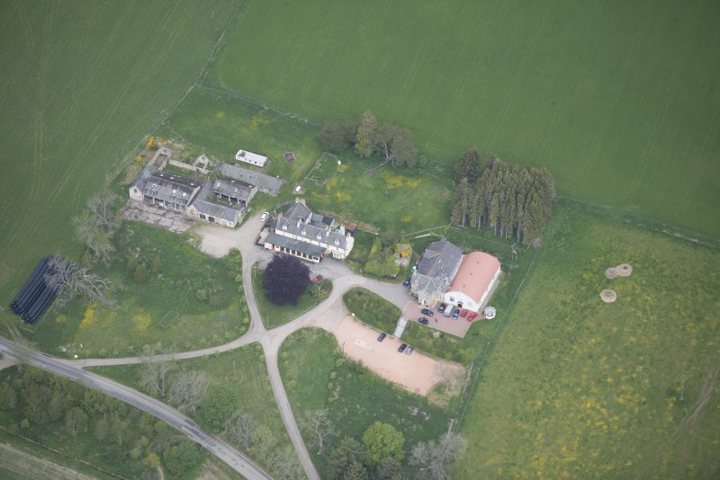 Oblique aerial view of Colquhonnie Hotel and Colquhonnie Castle, looking WNW.