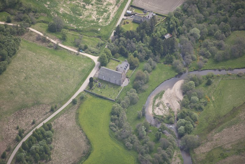 Oblique aerial view of Tombae Roman Catholic Church of the Incarnation and burial ground, looking SE.