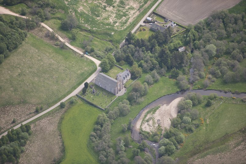 Oblique aerial view of Tombae Roman Catholic Church of the Incarnation and burial ground, looking ESE.