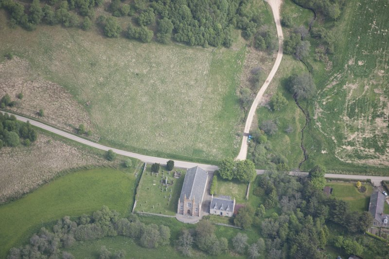 Oblique aerial view of Tombae Roman Catholic Church of the Incarnation and burial ground, looking NNE.