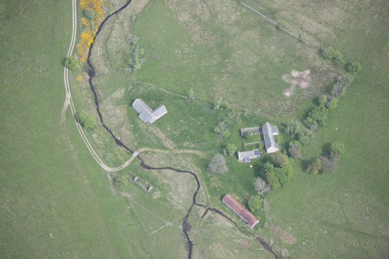 Oblique aerial view of Scalan Cottage and Roman Catholic Seminary, looking N.