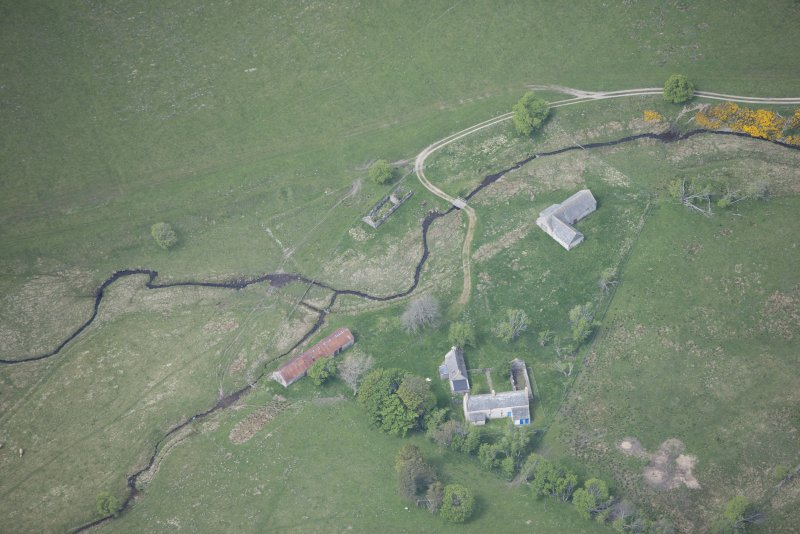 Oblique aerial view of Scalan Cottage and Roman Catholic Seminary, looking W.