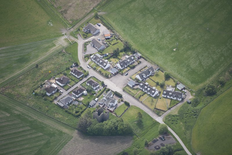 Oblique aerial view of Blairfindy Castle, looking SSE.